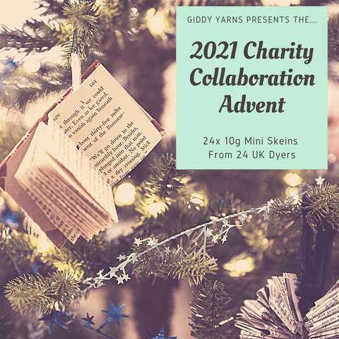 """Image of a book ornament hanging off a Christmas tree. In the top right corner, a mint green box has text that says """"Giddy Yarn Presents the 2021 Charity Collaboration Advent. 24 x 10g Mini Skeins from 24 UK Dyers"""""""