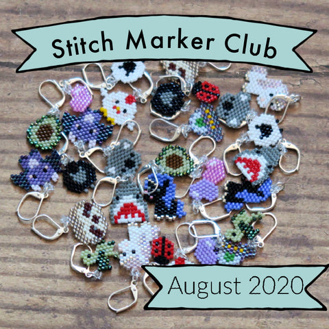 Pile of hand beaded stitch markers with a banner saying Stitch Marker Club August 2020