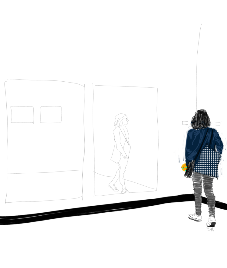 Young woman wearing blue and black walking through an art gallery