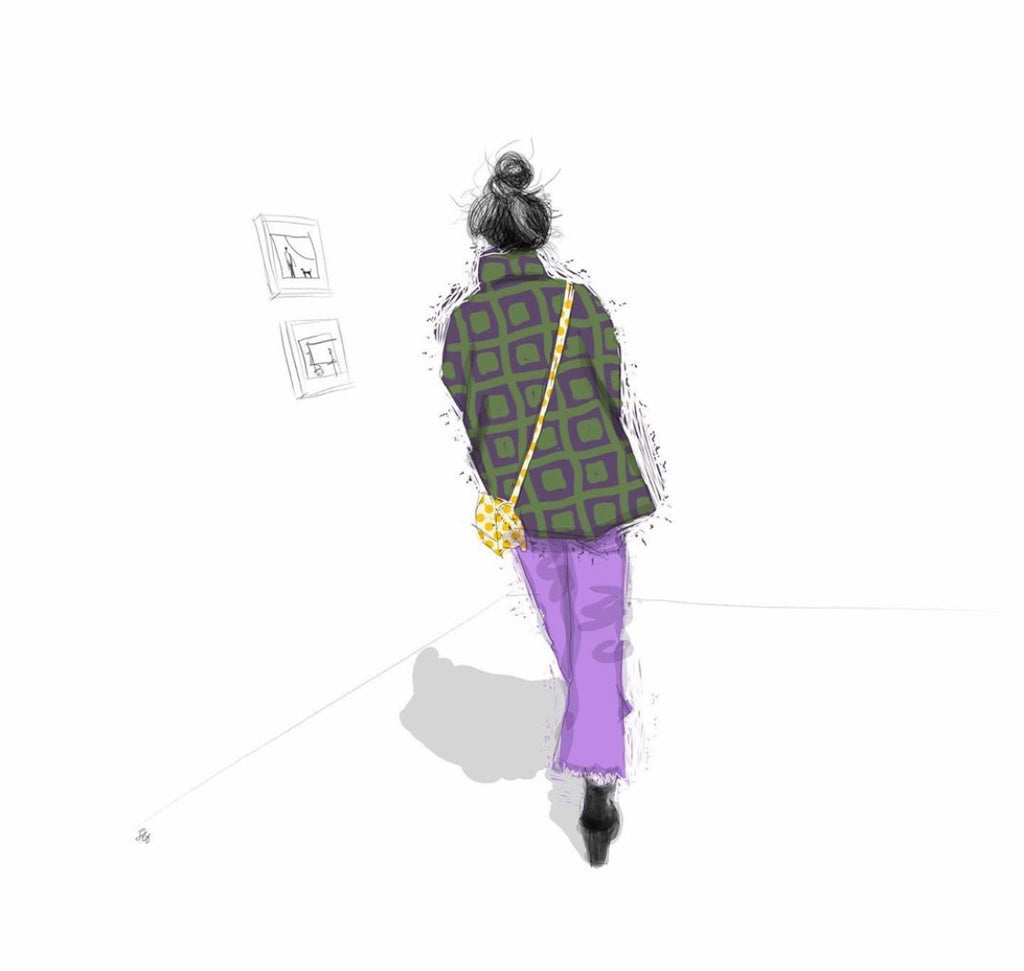 Woman wearing stylish purple trousers in an art gallery