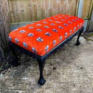 Orange velvet bench with skull design