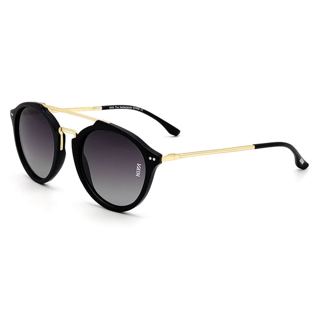 Aviator style sunglasses trendy black frame with gold temples fashion gradient gray lens side view