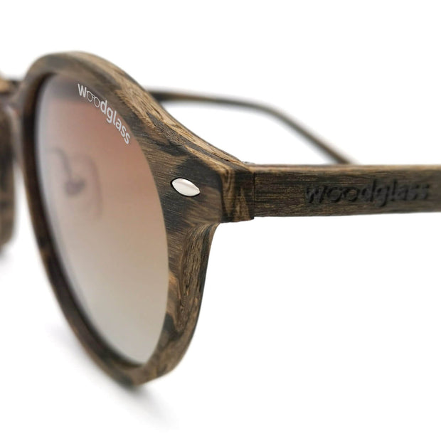Taman dark walnut wood immitation sunglasses with copper metal and gradient brown lenses that are polarized, UV400 and CE3 protected