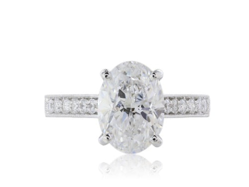 18 kt wg custom made oval Diamond solitaire engagement ring. GIA Oval E/SI2