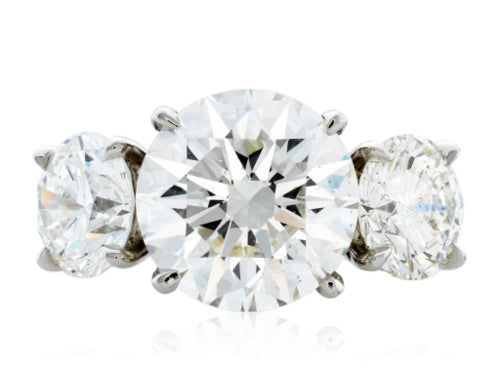 GIA Certified 3.51ct. H/SI1 Round Brilliant Cut flanked by 2 rbc diamonds 2.04 ct tw 3 stone ring