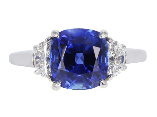 Plat Sapphire 4.13 and diamond 2@ 0.86 3 stone ring