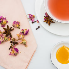 Load image into Gallery viewer, Tea with hibiscus, cacao beans, orange peel, elder berry, aronia berry, star anise, goji berry, rosa damascena, cinnamon and stevia leaf.