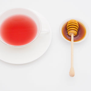 A cup of tea and honey.