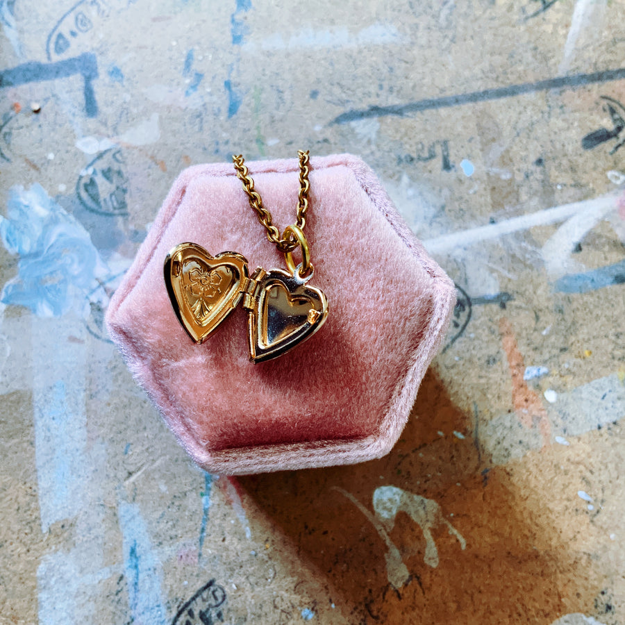Mini gold tone heart locket necklace