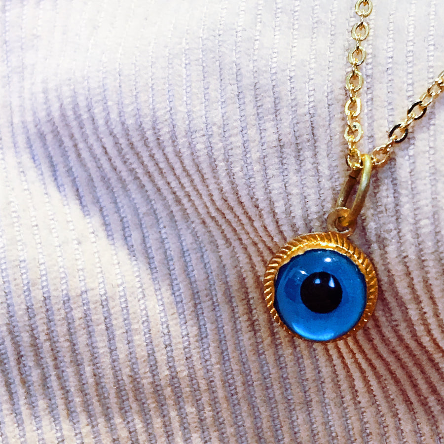 Double sided glass and gold evil eye necklace
