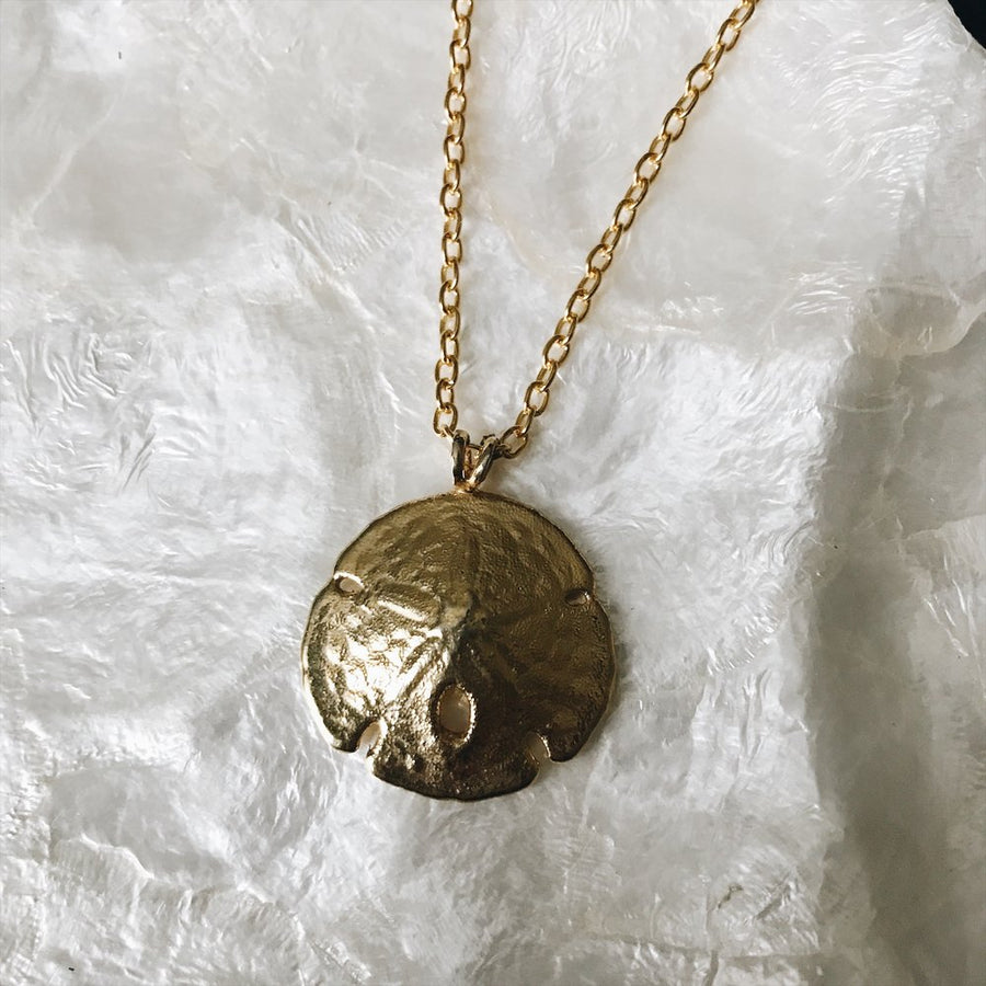 Vintage gold tone sand dollar necklace