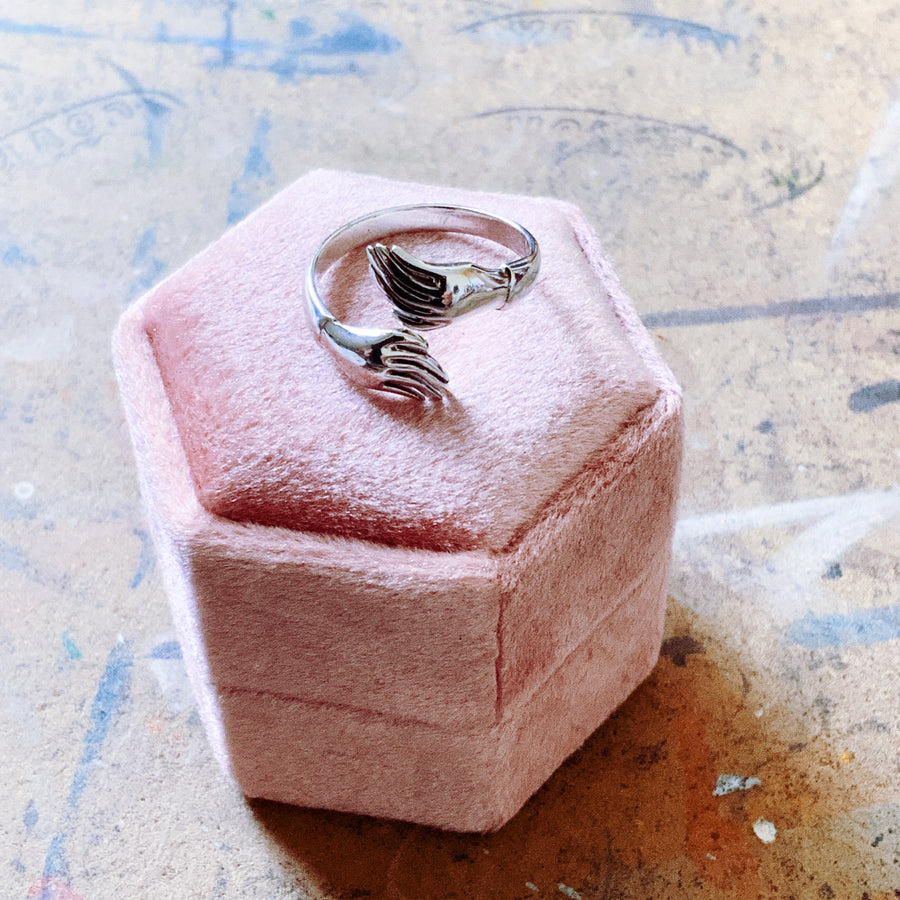 Sterling silver hugging hands ring