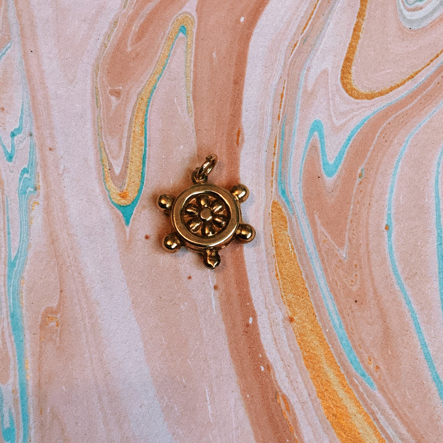 Puffy vintage gold plated ships wheel charm