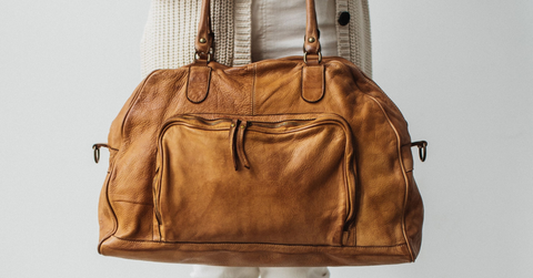 buttery soft vintage italian leather duffle bag with front pocket in cognac color