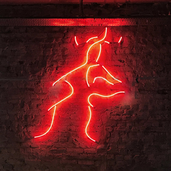 Close up of red kissing neon in London grind restaurant
