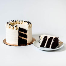 Load image into Gallery viewer, Cocoa and Fig Chocolate Vanilla Cake Sliced