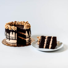 Load image into Gallery viewer, Cocoa and Fig Chocolate Chip Cake Sliced