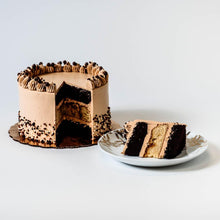 Load image into Gallery viewer, Cocoa and Fig Tuxedo Salted Caramel Cake Sliced