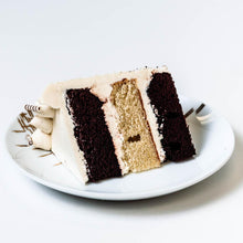 Load image into Gallery viewer, Cocoa and Fig Tuxedo Vanilla Cake Slice