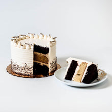 Load image into Gallery viewer, Cocoa and Fig Tuxedo Vanilla Cake Sliced