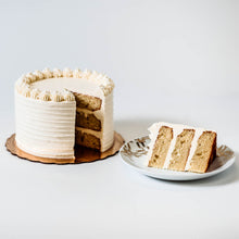 Load image into Gallery viewer, Cocoa and Fig Vanilla Cake Sliced