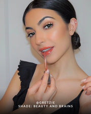 Beauty shot of a girl wearing Vasanti Power Oils Lip Gloss shade Beauty and Brains