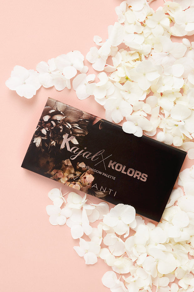 Vasanti Kajal X Kolors Eyeshadow Palette - High angle shot with white flower around.