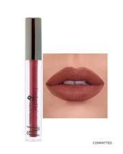 Vasanti Locked in Liquid Lipstick - Shade Committed on lips and product front shot
