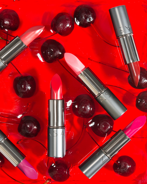 Vasanti Love Brights Gel Matte Lipstick floating in water with cherries lifestyle shot