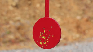 Red self-healing polymer reactive target with yellow color flare to indicate recent hits.