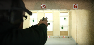 Reactive polymer targets being shot closely at close range indoors with a pistol to simulate a steel target shoot