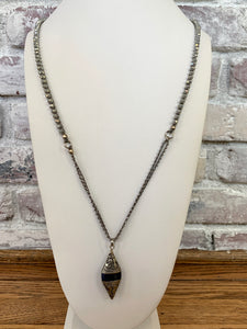 Hematite And Tibetan Charm Long Statement Necklace