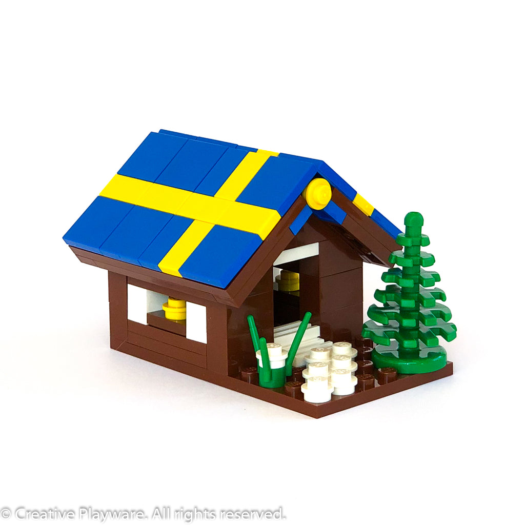 GINGERBREAD HOUSE No. 4 - SWEDISH FLAG roof