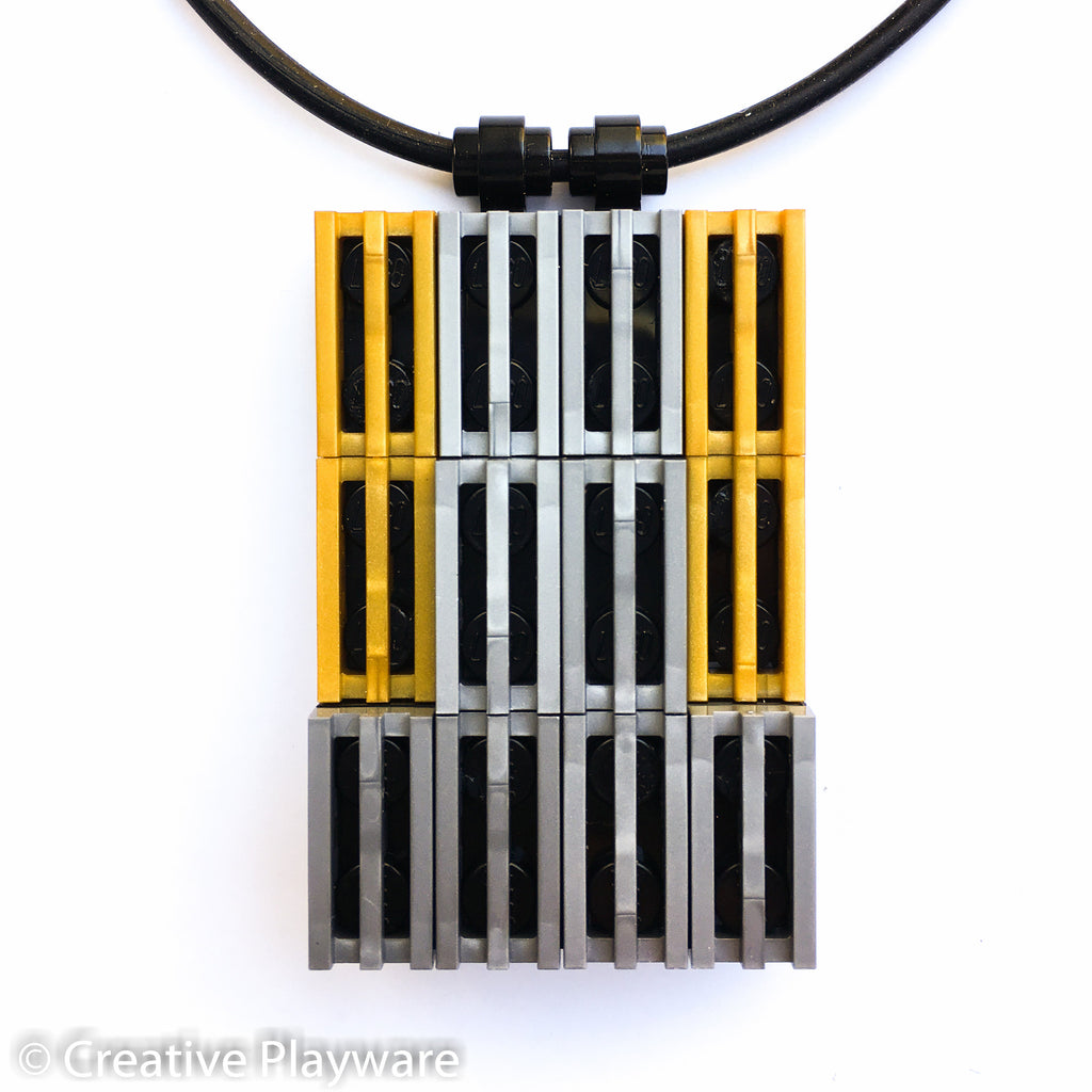 Pendant in gold and silver LEGO® bricks inspired by the New York skyline. HIGH-RISE pendant No. 1.