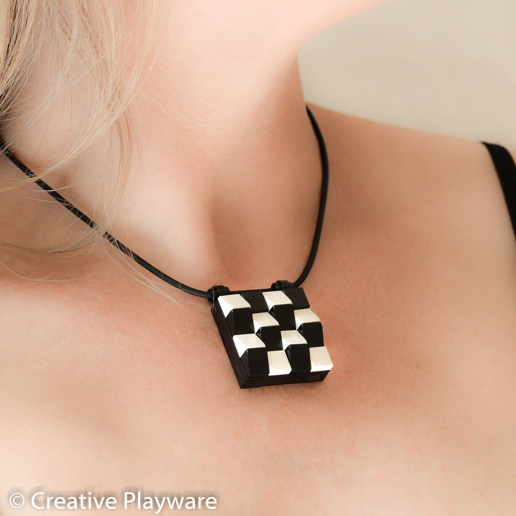 TESSELLATIONS Escher-inspired pendant made with LEGO® elements