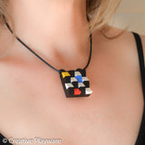 Escher-inspired pendant made with LEGO® elements