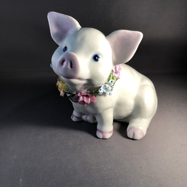 6859 Pig bank with garland