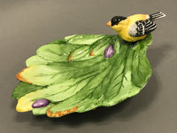 Goldfinch on leaves