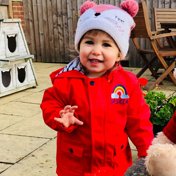 Red Baby Raincoat with Personalised Rainbow Design - Ruby and the Rainbow