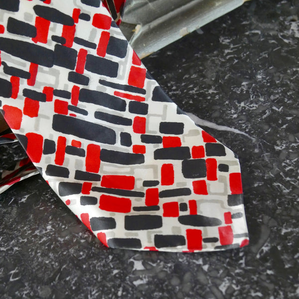 1980s Silk Necktie, European Vintage Abstract Red and Black Geometric Pattern on a Pale Silver Background - DownShifting Vintage Menswear
