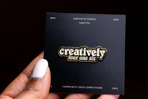 "Enamel Pin ""Creativelyfouronesix"" on backing card"