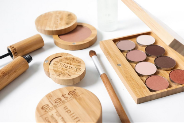 Elate cosmetics in bamboo cases including mascara eyeshadow and brushes