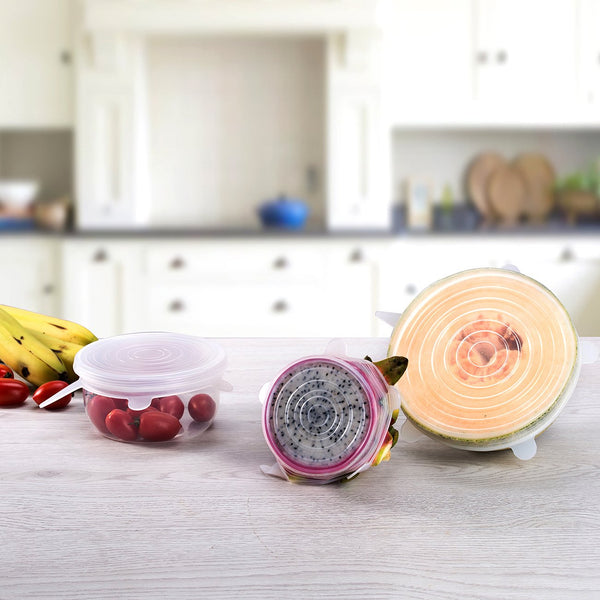 Silicone stretch lids cover fruits, vegetables and bowls on a kitchen counter top.