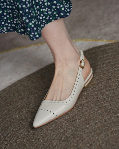 Pointed-toe Hollow-out Solid Color PU Leather Flat Shoes