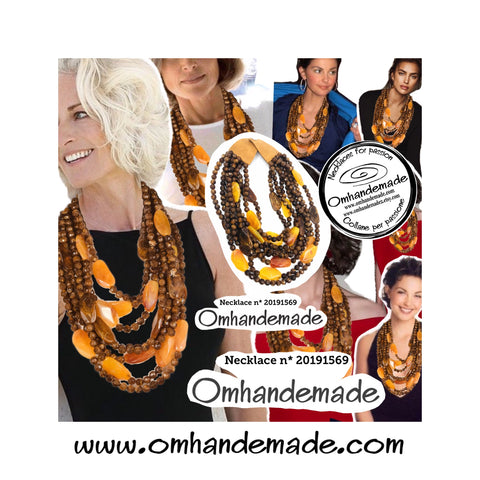 https://www.omhandemade.com/collections/shop/products/20191569-medium-necklace-layered-multi-wire-relief-to-8-strands-of-brown-beads-interspersed-with-large-orange-nuggets-yellow-papaya
