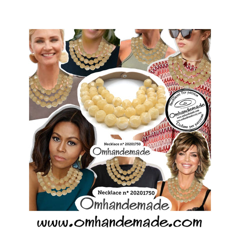 https://www.omhandemade.com/collections/shop/products/20201750-collana-girocollo-3-fili-in-resina-panna