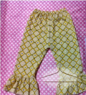 Yellow pants with geometric design