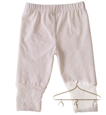Ivory capris with lace at cuff hem