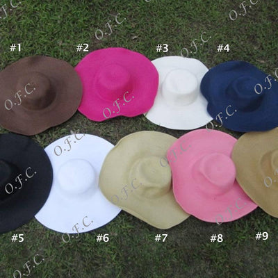 Women's wide brim straw hat in various colors