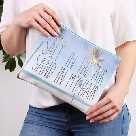 https://www.thebeachcompany.in/collections/beach-bags/products/palm-tree-slogan-clutch-bag